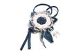 Simple pendant in the form of a handmade flower made of denim fabric on a white background Royalty Free Stock Photo