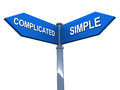 Simple vs complicated versus words on a street sign white background Royalty Free Stock Photo