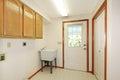 Simple white empty laundry room interior. Stock Photo
