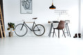 Simple, white room with bike