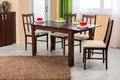 Simple wooden dinning table and chairs in interior - studio ambient room Royalty Free Stock Photo