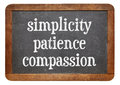 Simplicity patience and compassion three words from buddha teaching on a vintage slate blackboard Royalty Free Stock Image