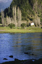 Simpson river chile white house alongside the riverbank of blue Stock Photo