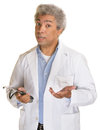 Sincere doctor understanding middle aged with palms up Stock Photography