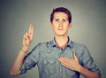Sincere man swearing with hand on heart Royalty Free Stock Photo