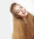 Sincere smile jubilant young woman with flowing healthy hairs pleasure toothy happy hair joy Royalty Free Stock Image