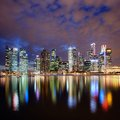 Singapore city skyline at night with reflection Stock Photos