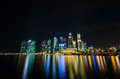 Singapore city skyline view of business district in the night ti time with beautiful water reflections Royalty Free Stock Image