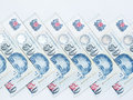 Singapore fifty dollar notes in a row on white background Stock Images