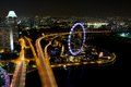 Singapore flyer aerial view on from marina bay sands resort at night Royalty Free Stock Photos