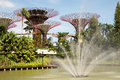 Singapore march gardens by the bay in marina bay in singapore march close view on fountain and steel structures called super trees Stock Photo