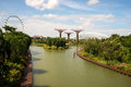 Singapore march gardens by the bay in marina bay in singapore march view on and ferris wheel editorial horizontal view Stock Photos