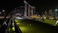 Singapore marina bay panorama at the night in with bridge crossing Stock Photos