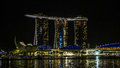 Singapore marina bay panorama at the sunset in night with reflection on water in harbor Royalty Free Stock Image
