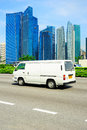Singapore road white minibus on the in blured motion Stock Image