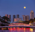 Singapore skyline singapore river cavenagh bridge evening Stock Images