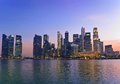 Singapore skyline sunset at marina bay and Royalty Free Stock Photos