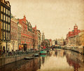 The singel is one of the numerous canals in amsterdam netherlands background munttoren photo retro style paper texture Royalty Free Stock Image