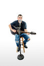 Singer acoustic guitarist on white looking forward a Stock Images