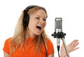 Singer in headphones singing with the microphone Stock Image