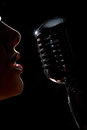 Singer with microphone Royalty Free Stock Photo