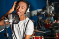 Singer recording a track in studio young male Royalty Free Stock Photos