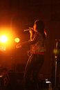 Singer in rock band performance a lady sings during a on stage national institute of technology nit silchar purple fusion of Stock Image