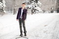 The singer in a suit and a scarf stands and sing outdoors winter Royalty Free Stock Photo