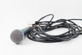 Singin microphone and wire cable isolated on a white background music Royalty Free Stock Images
