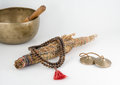 Singing Bowl, Smudge Stick, Prayer Beads and Meditation Bells. Royalty Free Stock Photo