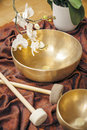 Singing bowls an image of some and a white orchid Stock Photos