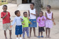Singing and dancing children in south africa to collect money from tourists Stock Image
