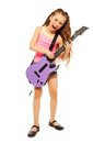 Singing girl rocks playing on electro guitar with long hair white background Stock Photo