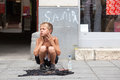 Singing on the street for money sarajevo bosnia and herzegovina aug sevdalija osmanovic august in sarajevo b h this boy is Stock Image