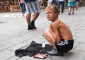 Singing on the street for money sarajevo bosnia and herzegovina aug sevdalija osmanovic august in sarajevo b h this boy is Royalty Free Stock Photos