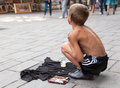 Singing on the street for money sarajevo bosnia and herzegovina aug sevdalija osmanovic august in sarajevo b h this boy is Royalty Free Stock Images