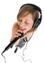 Singing wide angle shot of girl with microphone Stock Photo