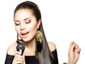 Singing woman beauty with microphone Stock Photo