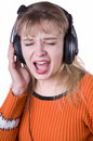Singing woman is listening to the music Royalty Free Stock Image