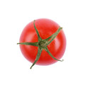 A single bright red tomato, isolated on a white background. Tasty, fresh and juicy red tomatoes, top view. Royalty Free Stock Photo