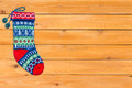Single brightly colored woollen Christmas stocking Royalty Free Stock Photo
