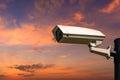 Single CCTV Security camera on beautiful sunrise sky Royalty Free Stock Photo