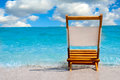 Single chair at the beach empty and selective focus on Stock Photo