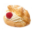 Single cream bun with raspberries cream and vanilla powder studio Stock Images