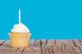 Single cupcake with pink candle Royalty Free Stock Photo