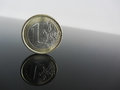Single Euro coins on grey background Royalty Free Stock Photo