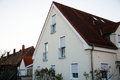 Single family house in Munich, blue sky, white facade Royalty Free Stock Photo