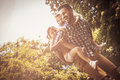 Single father playing in nature with his daughter. Royalty Free Stock Photo