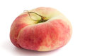 Single flat peach on white with selective focus Royalty Free Stock Photo