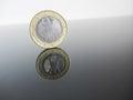 Single German Euro coins on grey background Royalty Free Stock Photo